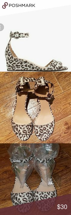 K. Crew print wedge sandals size 6 1/2 These special J.Crew low wedge sandals are super cute.  Animal print and has hints of silver sparkles.. Approx 2 in heel.  Size 6 1/2.  These shoes have been worn but are in super shape... Pic#1 is a stock photo. J. Crew Shoes Sandals