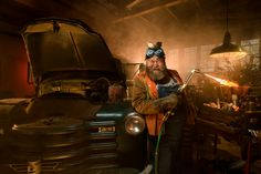 There's something about an old garage, an even older truck, an oxy-acetylene torch wielding dude who could have had a cameo in Texas Chainsaw Massacre, and a bunch of tarnished, beat up junk that makes Creative Portraits, Creative Photography, Lifestyle Photography, Portrait Photography, Professional Photography, Corporate Portrait, Business Portrait, Paris Texas Film, Old Garage