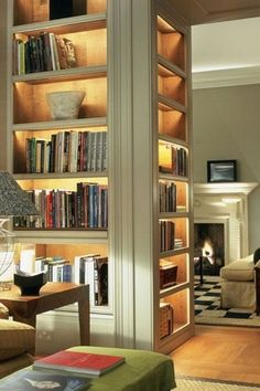 """Lighted shelving makes great room divider, reduces clutter, gives soft light, and space is still functionally open.   From """"Zillow Digs."""""""