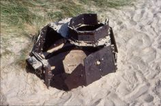 A rusting tank turret converted into a defensive position. Omaha beach, I think.