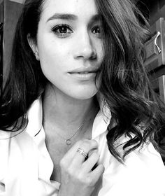 Meghan Markle snaps a selfie in a classic white shirt