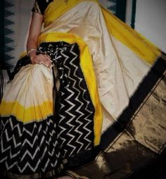 White Ikkat saree with zig zag pattern in yellow with black border. Comes with an attached blouse. Ikkat Pattu Sarees, Pochampally Sarees, Bandhani Saree, South Indian Sarees, Ethnic Sarees, White Saree, Black Saree, Pure Silk Sarees, Cotton Saree