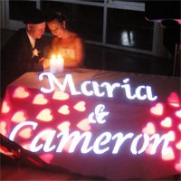 Names in lights with red hearts. This was taken at Newcastle. This shot was taken under candle light at the end of the reception. Another DJ MAGOO classic wedding.