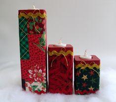 Belíssimo trio de velas natalinas em mdf forradas com tecido 100% algodão e com detalhes em passamanaria e cordão dourado. Acompanha 3 velinhas eletrônicas com pilhas.    Medidas das velas:  grande => 7x7x24cm  média => 7x7x14cm  pequena => 7x7x10cm