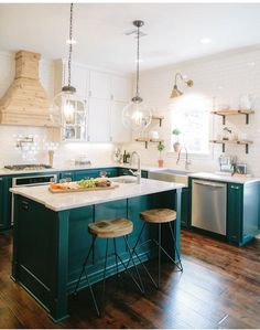 Don't like the stools, but love the idea of richly colored bottom cabinets!