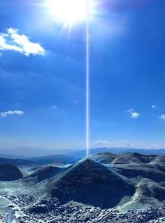 """A team of physicists detected an energy beam coming through the top of the Bosnian Pyramid of the Sun. The radius of the beam is 4.5 meters with a frequency of 28 kHz. The beam is continuous and its strength grows as it moves up and away from the pyramid. This phenomenon contradicts the known laws of physics and technology."