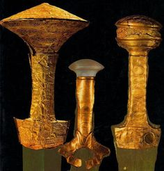 A closeup of the gold-work on three LHIIB (1600/1550-1435/1405 BCE) Mykenaean swords.