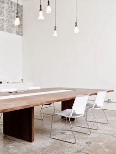 Ampoules Plumen home office boardroom table lighting bulbs white walls concrete like flooring