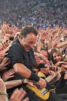Bruce Springsteen - Comfortable with his adoring fans. . . . . . . . sami