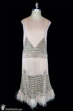 1920s flapper era dress, heavily beaded silk chiffon wedding or evening dress, Art Deco jeweled rhinestones, ostrich feather, pintucks, 1930 by TheFrockDotCom on Etsy https://www.etsy.com/listing/516985428/1920s-flapper-era-dress-heavily-beaded