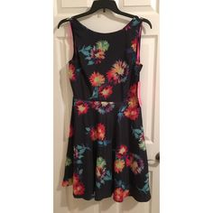 BETSEY JOHNSON MIDNIGHT FLORAL FIT FLARE DRESS 12 NWT. Authentic. Size 12. Midnight navy floral dress with gorgeous back cutout. Brand new, never worn. No flaws rips or stains. 100% polyester. Boatneck, Sleeveless, gathered waist, tulle beneath hem, V-back, fully lined. Please ask all questions and view photos before purchase. No trades, no PayPal. Thanks! Betsey Johnson Dresses Midi