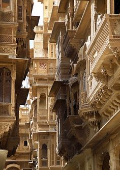 "Located in India's Thar Desert in Rajasthan, the ""Golden City"" of Jaisalmer gets its colour from buildings made of yellow sandstone (even more beautiful at sunset). For thousands of centuries the city was an important post on camel routes from India to CENTRAL ASIA to trade Indian goods and KNOWLEDGE (also through which the INDIAN NUMBERS created in India..travelled to Europe via Central Asia, as well as BAUDHAYANA THEOREM). HAVELIS are elaborate sandstone MANSIONS created in ancient India."