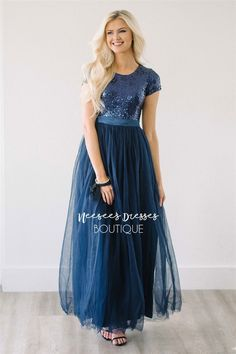This feminine dress is everything you have been looking for! Sequins, sparkles, tulle and modest too! The bodice features short sleeves, a round neckline and is covered in tiny navy sequins and followed by a navy tulle skirt.