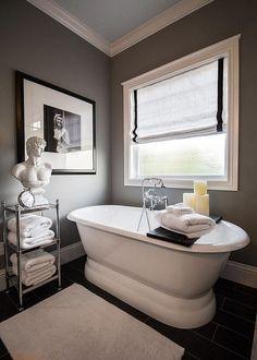 Amazing master bathroom boasts a freestanding oval tub, Rejuvenation Double End Pedestal Tub, and ...