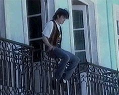 """themjquotes:  Michael: """"Let me just balance off a three story building while lip-syncing for video shoot, What could possibly go wrong?"""" I have no idea what Michael was thinking about while doing this lol, that balcony was wobbly as fuck. He really is like a child just having fun and doing stupid things."""