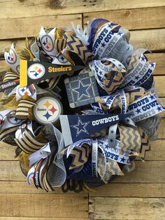 House Divided Team Wreath, Steelers Wreath, Cowboys Wreath, Pittsburgh Steelers, Dallas Cowboys, NFL Team Wreath, House Divided Custom Wreath   These are a hot item and can be custom made with the Teams of your choice! This particular one, as you can see in the photos, is the Pittsburgh Steelers (my home team) and the Dallas Cowboys. The wreath measures about 24 in diameter and 8 deep and is loaded up with Team spirit! What a great gift idea!  MADE TO ORDER! Is your house divided when it…