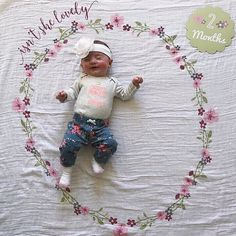 2 months!  @kristinaamariee  Mark her milestones with Floral Swaddle & Card Sets! spearmintLOVE.com