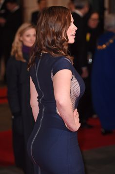 Hayley Atwell booty and side boob in curve hugging dress