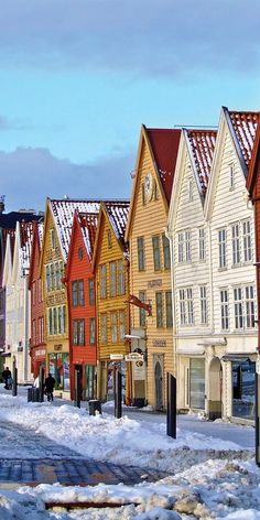 Colourful snow-capped homes in Bergen, Norway.