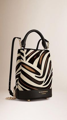 e94072e8ec2b Burberry Bucket Backpack in animal-print calfskin with chain and leather  straps.  animalprinthandbags