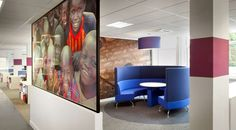 Workplace design for Sightsavers by Morgan Lovell.  This circular seating booth is perfect for collaboration. Images of the people the charity supports adorn the walls providing inspiration and motivation to the people working there.   Bright colours and a specially marked walkway mean that every member of staff, including those who are partially sighted, can easily find their way around the office.  See more of this office design in the video and case study...
