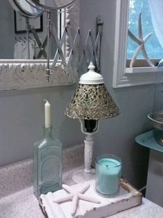 Light blue candles, extendable mirror, and the marble isn't too bad White Bathroom Accessories, Blue Candles, Thrifty Decor, Bathroom Towels, Awesome Bedrooms, Mason Jar Lamp, Decorative Bells, Table Lamp