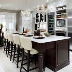 Candace Olson kitchens, what a beautiful custom Island, love the space, contrast and functionality.  See a few of our custom islands http://kitchenazcabinets.com/mesa-phoenix-az-kitchen-cabinets-gallery