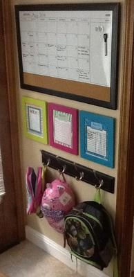 Family calendar, weekly menu and chore charts in nook by entryway where the whole family can see them! {featured on Home Storage Solutions 101}