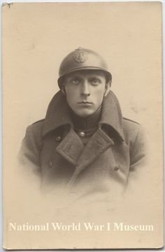 Black and white portrait photograph of an unidentified Belgian soldier with Adrian helmet.