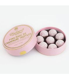 Lightly dusted pink coloured truffles with a milk chocolate butter and Marc de Champagne centre.