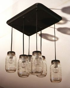 Step-by-step directions for making your own stylish, re-purposed mason jar lights. Use them individually as pendants, or combine to make a chandelier as demonstrated here. C'mon, you know you want to!