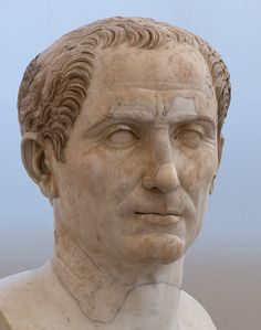 Head of Julius Caesar from the Trajan's forum.  Marble. A.D. 117—138. Inv. No. 6038. Naples, National Archaeological Museum. Origin:From the Farnese collection.