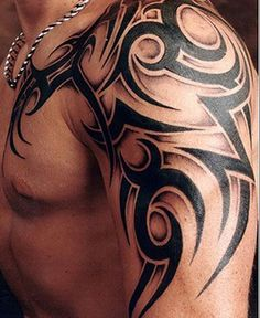 Best Tattoo Trends - man-left-shoulder-tribal-tattoo...