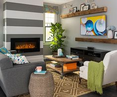Not satisfied to sit simply in the background, this sleek fireplace comes to the forefront, thanks to painted on stripes: http://www.bhg.com/decorating/fireplace/styles/fireplace-designs/?socsrc=bhgpin102414contemporarydesign&page=8