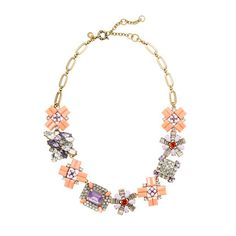 Geometric bouquet necklace  Inspired by a handful of vintage earrings, our designer created this brightly colored geometric-stone necklace in a must-get melangé of crystals and superbright violet and fiery orange stones.