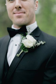 White floral boutonniere Photo @EmilyWrenPhotography http://www.weddingchicks.com/blog/natural-white-grey-and-green-wedding-l-13462-l-5.html