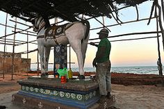 Painter preparing a statue for a celebration. Close to the Indian Ocean Cocomandel Coast Pondicherry.