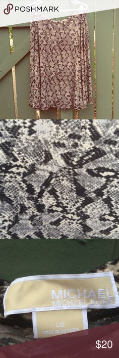 Michael Kors Snake Print Skirt Worn once. Great condition. Could fit an XL. Bundle any three items and save 30%! Don't be afraid to make an offer! Michael Kors Skirts