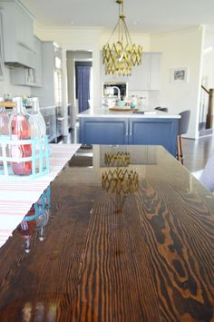 Super glossy custom made banquette table. It was mirror smooth. Banquette Table, Jacobean Stain, Young House Love, Dining Room Inspiration, Furniture Makeover, Diy Furniture, Colorful Interiors, House Colors, Home Kitchens