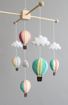 This is a PDF tutorial on how to make a hot air balloon baby mobile for a crib/cot.  Hand crafting a crib mobile for your baby is easier than you think! Follow the clearly illustrated diagrams and use the cut out templates to create a beautiful mobile. You can choose colours to suit your your nursery and embellish with your own ideas to make it truly unique!  The guide will take you through all the steps. $7.10 Etsy