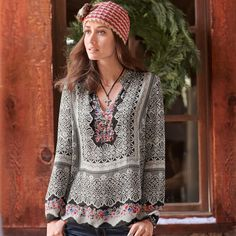 """VITA TUNIC--A delicate lace print with a pop of wildflowers recalls mountain villages and time-honored traditions on our flowing, floral silk georgette top with scattered sequins. Camisole included. Spot clean. Imported. Exclusive. Sizes XS (2), S (4 to 6), M (8 to 10), L (12), XL (14). Approx. 27""""L."""