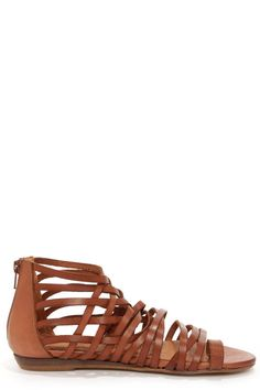 """Our hearts skipped a beat the moment we laid eyes on the Sixtyseven 75961 Ashley Vachetta Brandy Gladiator Sandals! Brown leather straps create an elaborate caged upper with a single strap encircling the big toe, plus crisscrossing that climbs right up to the ankle. A 3"""" heel zipper offers convenience above a 1/2"""" wedge heel. Lightly cushioned insole. Non-skid synthetic sole. Available in European sizes, 36-41. Measurements are for a size 36. Leather upper. Balance man made."""