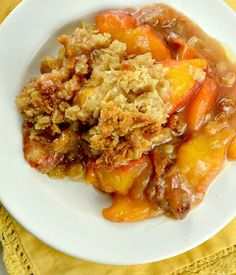 I must really love my husband, because it's 90 degrees, we have no air conditioning and I'm making him this Peach Crumble!!!