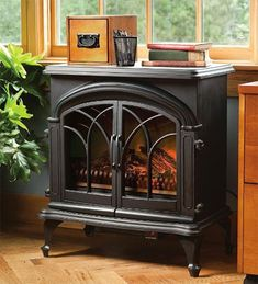 Portable electric stove heater stays cool to the touch. Wood stove heater has flame and heat functions for a real fire look, and heater warms up to 400 sq. Concrete Fireplace, Faux Fireplace, Fireplace Inserts, Ikea Fireplace, Craftsman Fireplace, Fireplace Bookshelves, Fireplace Cover, Freestanding Fireplace, Limestone Fireplace
