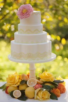 Beautiful wedding cake with citrus and orange flowers