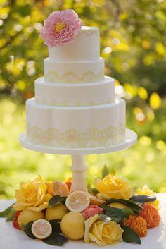 Beautiful wedding cake with citrus and orange flowers