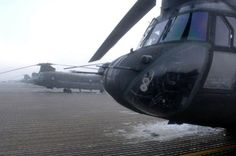 U.S. Army CH-47 Chinook helicopters from Alpha Company, 7th Battalion, 158th Aviation Regiment sit on Bagram Air Base, Afghanistan, awaiting to depart on a early morning missions Jan. 26, 2007