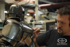 Trevor L. Hensley brings out the metallic highlights on the maquette for the cave-built Mark I suit from IRON MAN.