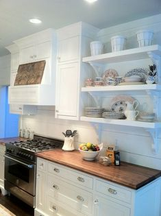 Love the white horizontal planking on the backsplash and the open shelving.