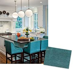 A kitchen, decorated in turquoise and white I love the color of the bar stools